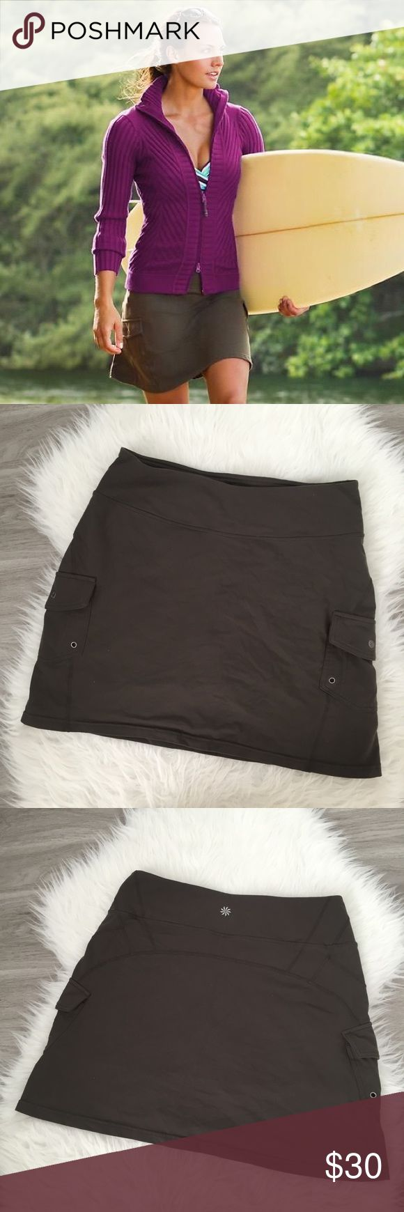 Athleta Oasis Skort Olive Green w Pockets Size M  Waist: 15in flat Length: 16in flat Stretchy and very comfortable! Has shorts underneath for coverage.   Athleta Oasis Skort  Athleta Oasis Skort ($64): moisture-wicking with CoolMax technology, the Oasis skort is also made with built-in UPF 50+ sun protection Athleta Skirts Mini