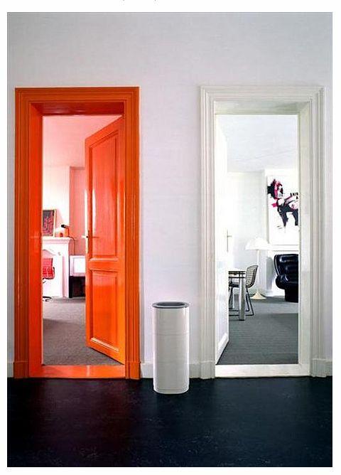 Make an Entrance. In lieu of an accent wall, why not an orange accent door frame?