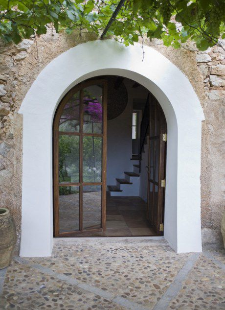 Love the arched french doors in this farm house in Spain.