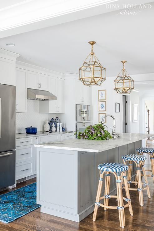 Two Suzanne Kasler Morris Lanterns Hang Over A Dove Gray Kitchen Island Topped With White Marble Ed Sink And Polished Nickel Gooseneck Faucet
