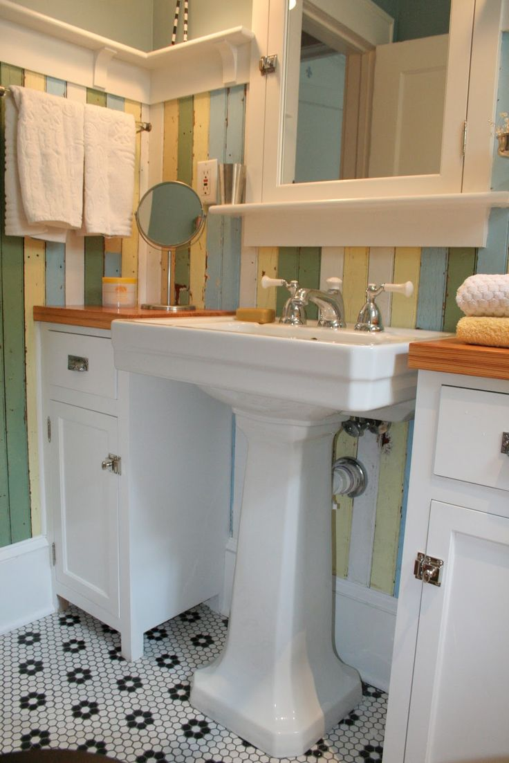 Love the pedestal sink with the cabinetscounters on each