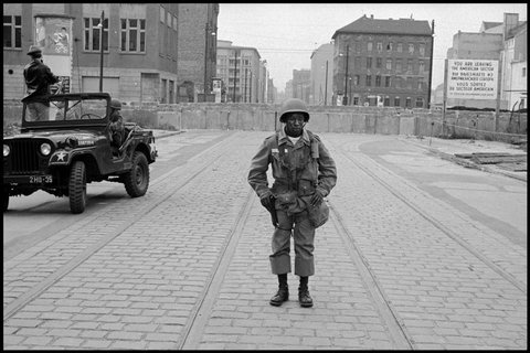 """""""American soldier stands guard as the Berlin Wall is put up,"""" Leonard Freed (Berlin, 1961)"""