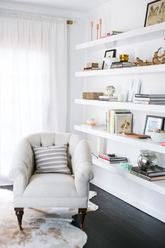 Use floating shelves for a more minimalist bookshelf - wall just to the right of the sofa, or wall next to desk in corner