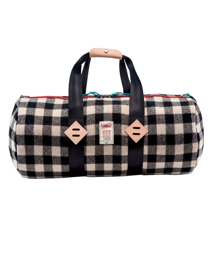 """Topo Designs teamed up with the venerable outdoor brand Woolrich to create  a new twist on the classic duffel.Simple on the outside, beautifully lined  with coated nylon pack cloth on the inside. Comes with a detachable  shoulder strap, inside zipped pockets and a natural leather handle.  Made in Colorado by Topo Designs with American-made Woolrich fabric. Dimensions:22""""l x 11""""w x 11""""w Volume:2090 cu. in./34 L Materials:100% Woolrich wool outer with coated pack cloth liner…"""