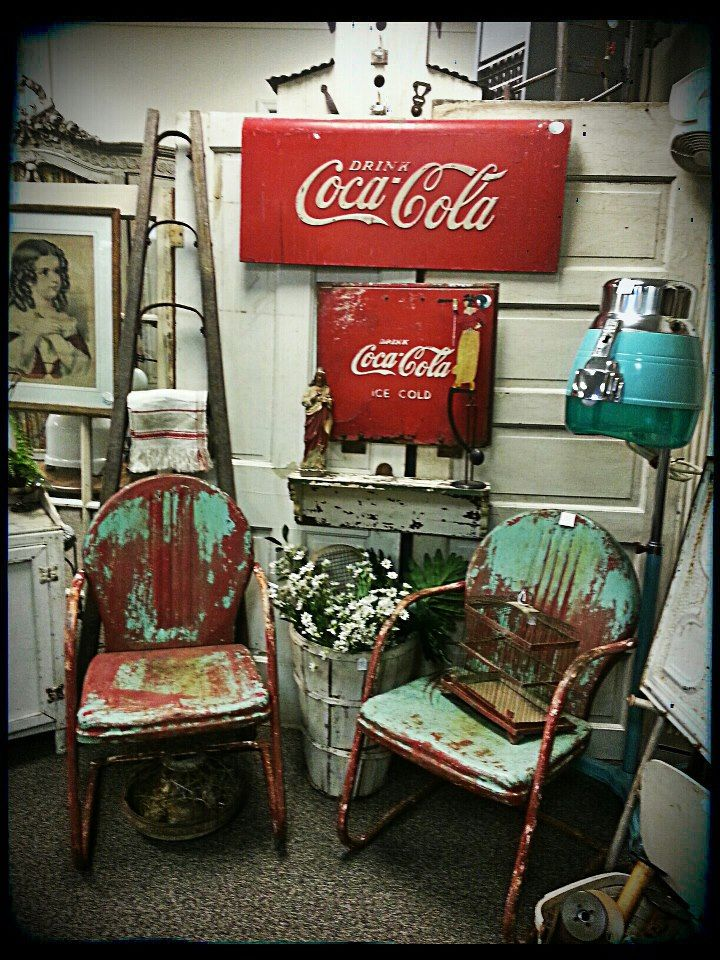 Great old metal chairs $sold for the pair, an antique ladder, coca cola signs, a vintage working hair dryer!!