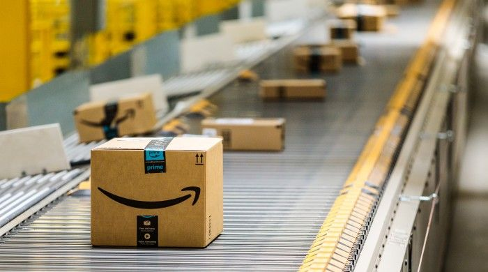 Amazon Delivery Boxes Roll Down A Conveyor Belt At Amazon S