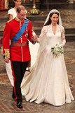 Ten years after meeting at university, Kate Middleton married Prince William at Westminster Abbey on April 29 2011, becoming HRH The Duke and Duchess of Cambridge. Throughout their six-month engagement, the designer of Kate's wedding gown was kept a secret, leading to intense global speculation. The designer was finally revealed as Alexander McQueen creative director Sarah Burton - but not until the final moment when Kate was making her entrance into the Abbey.
