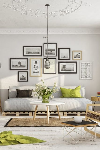 Gallery wall with framed photograph organization and pallet couch. Gorgeous!