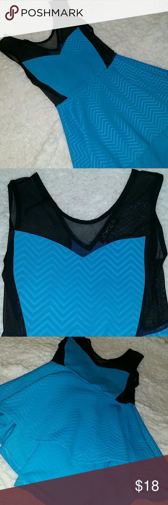Cyan chevron mesh panel hi low peplum top Really cute top with a high low peplum and mesh panels on the sides and top light chevron pattern throughout. Never wear it. Maybe worn twice. Bought from tellos. Tops