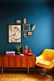 Image result for teal feature wall orange wood living room
