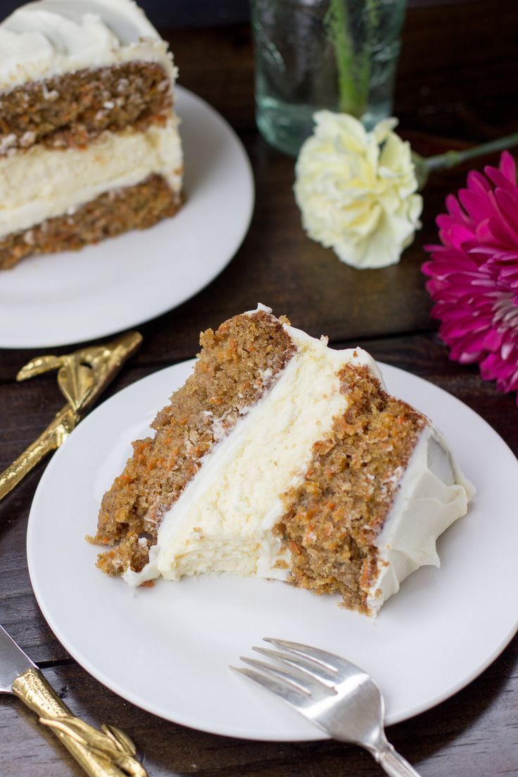 Incredibly moist, perfectly-spiced carrot cake with a rich layer of cheesecake and frosted with a whipped cream cheese icing.