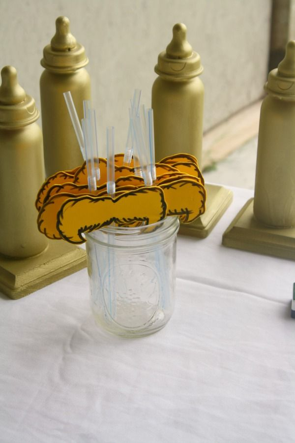 Lorax mustache straws for a Dr Seuss baby shower
