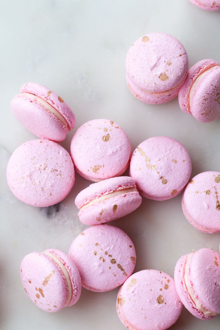 Gold splattered French macarons filled with punchy pink peppercorn buttercream and luscious Valrhona Guanaja 70% chocolate ganache. Perfect for this Valentine's Day!