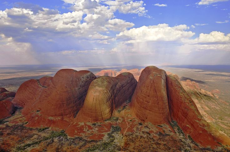 Kata Tjuta - also known as Mount Olga (or colloquially as The Olgas) - is located in the southern part of the Northern Territory (Central Australia).  / Uluru (Ayres Rock) lies 25 km (16 mi) to the east.