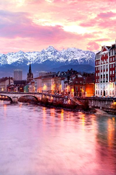 Grenoble is a pretty city in France nestled between the French Alps. There are many skiing resorts nearby.