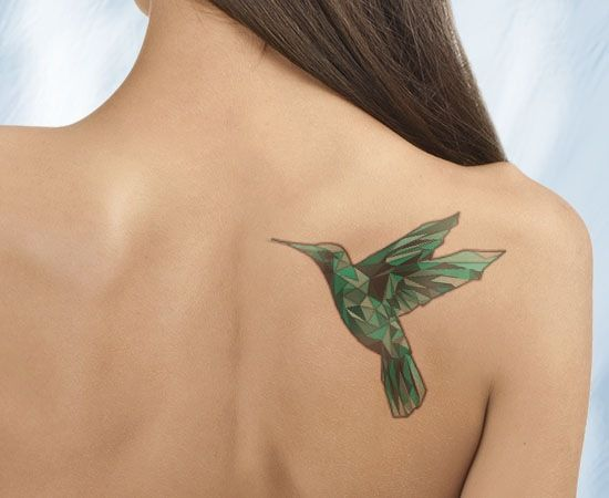 Woman with Green Geometric Hummingbird Tattoo on Shoulder Blade