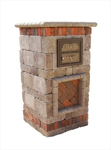 Loving this stone mailbox! very intereseting contrasts between brick layers and the stone color. the inset mailbox of iron and gold or brass is also attractive