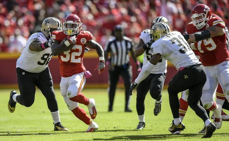 Saints vs. Chiefs  -  27-21, Chiefs  -  October 23, 2016:   Kansas City Chiefs running back Spencer Ware (32) broke free from New Orleans Saints defensive tackle John Jenkins (92) for a 46-yard touchdown pass at Arrowhead Stadium in Kansas City, Mo. on October 23, 2016. The Chiefs won, 27-21.