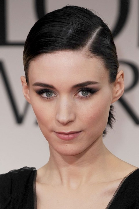 Rooney Mara, meanwhile, channelled the edgy gothic glamour of her latest on-screen persona – The Girl With The Dragon Tattoo's Lisbeth Salander – with pale foundation, smoky eyes, a nude lip and her jet black locks worn poker straight in a side parting and a low ponytail.
