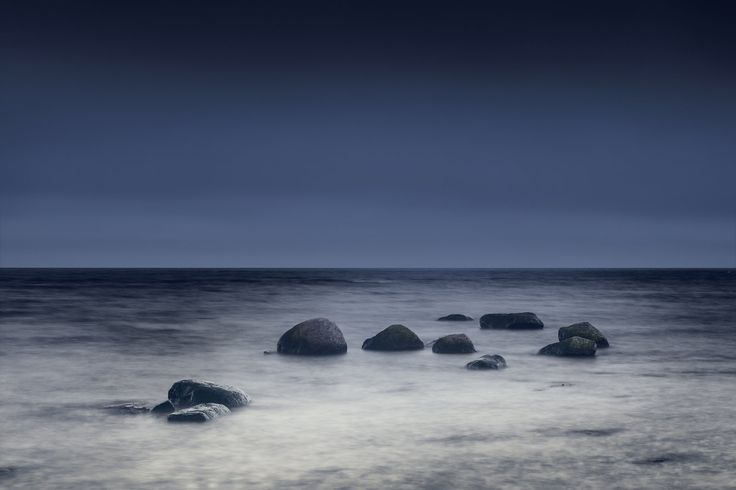 Black stones in a slivery sea, intriguing and slightly mysterious; leading your eye to the horizon, slightly brooding but inviting. Walk on the stones, swim in cool sea following the silvery path, maybe to see a mermaid! This stones in the sea mural lends itself to a bit of magic, a staging of fantasy. It would look great in minimalistic style décor, bringing interest to the décor without being overwhelming. This extraordinary photo wallpaper is simple and calm yet not still, you can sense…