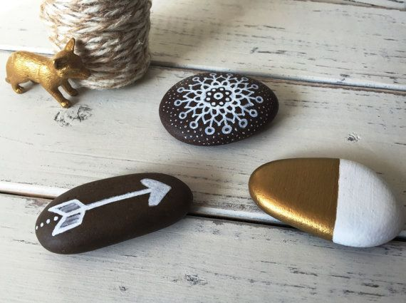 Hand painted rocks // White and gold Arrow by RusticOnTheRocks