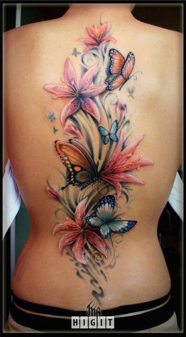 Back piece flower tattoos with butterflies - I like how the butterflies added more colours on this back piece flower tattoos. They are both beautiful creatures. #TattooModels #tattoo