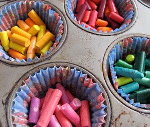 Melt old crayons in the oven at 200 degrees for 20-30 min.   I'm gonna use this for earth day to make tiny earth's out of blue & green crayons