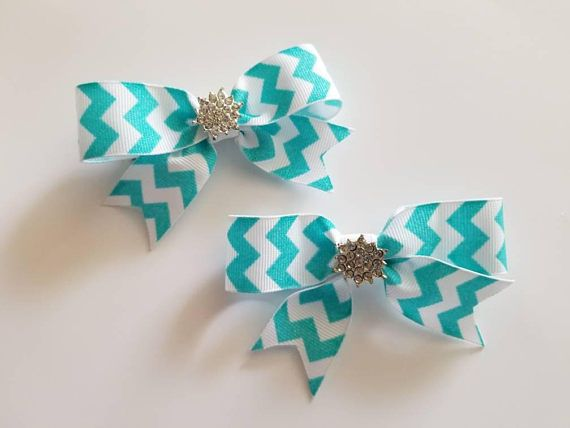 Check out this item in my Etsy shop https://www.etsy.com/listing/540399963/teal-an-white-chevron-bows-bling-bows