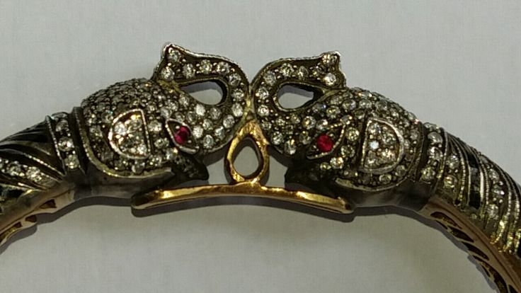 Diamond, black enamel and ruby Bracelet with Elephant Heads.