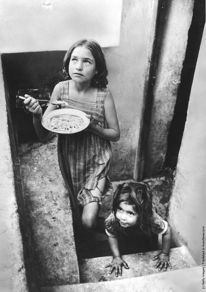 Refugee children in a filthy cellar at Piraeus during the Greek Civil War. (Photo by Haywood Magee/Picture Post/Getty Images). 1st November 1947