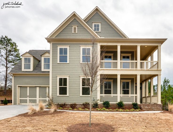 The Donaldson | Woodmont Golf and Country Club | Canton, Georgia | Painted exterior with double wraparound front porches. Side two-car garage.