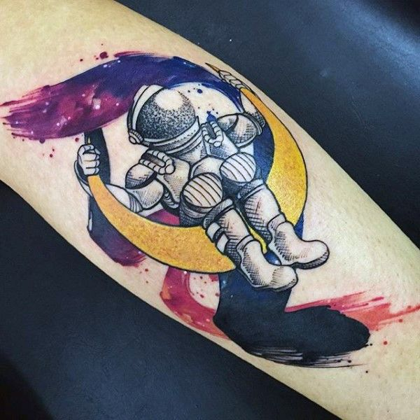 Old school style colored astronaut on moon arm tattoo