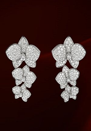 These 18K white gold and diamond earrings with paved diamonds are from the Caresse d'Orchidees collection by Cartier.