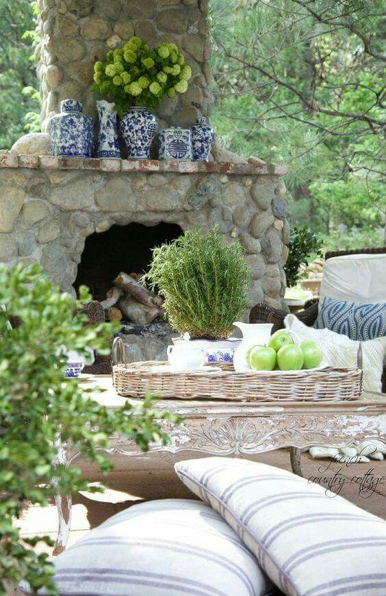 Outdoor stone fireplace. French country cottage.