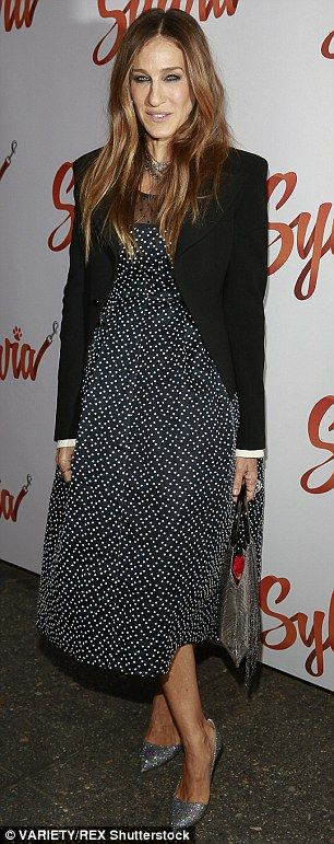 Pretty in polka dots: The star wore a black and white polka dotted dress with a black blazer