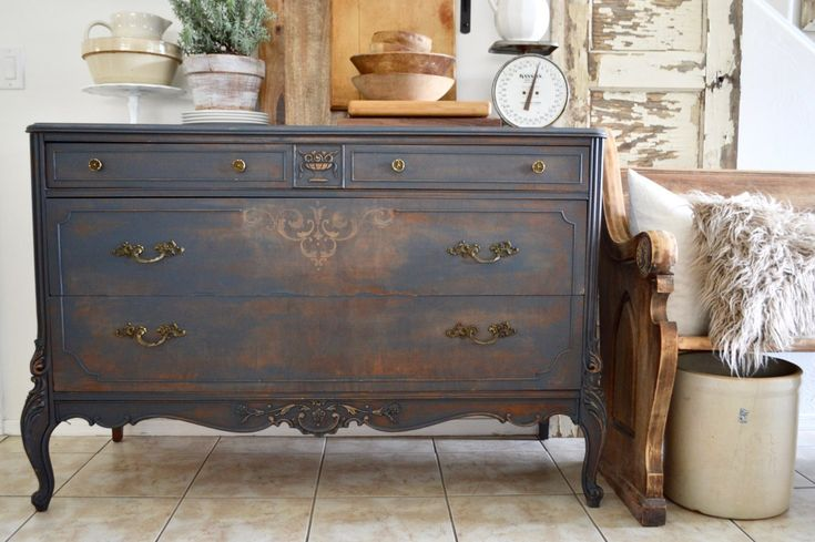 How to Get This Distressed Paint Finish - tutorial shows how this Craigslist dresser was transformed using homemade black chalk paint - via My Vintage Porch
