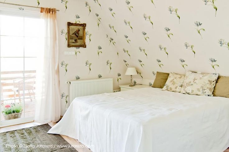 Sleeping room with flowers on the wall
