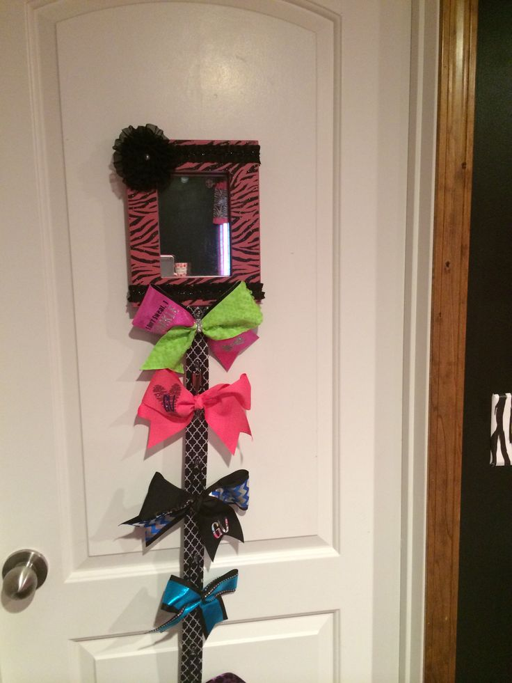 Just DIY'd a cheer bow holder. I think I need to add more hooks to fill in spaces and she has way more bows.