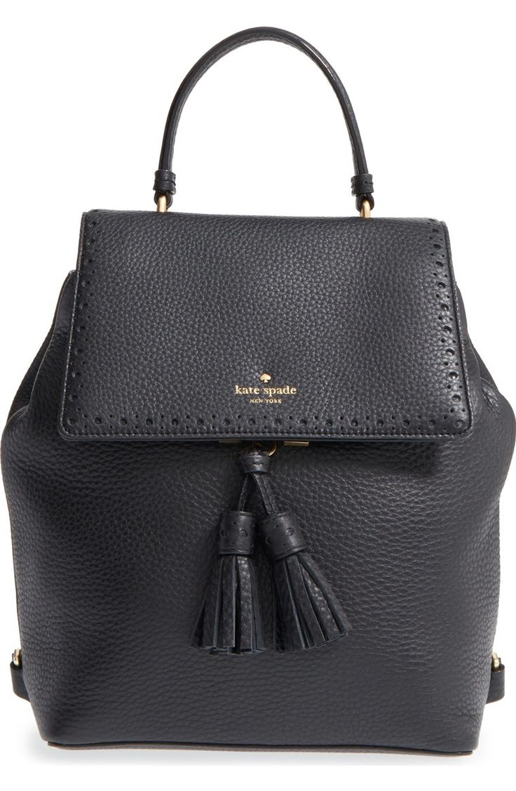 Dual tassels and a brogue-trimmed flap enhance the vintage sophistication of this perfectly proportioned backpack by Kate Spade.