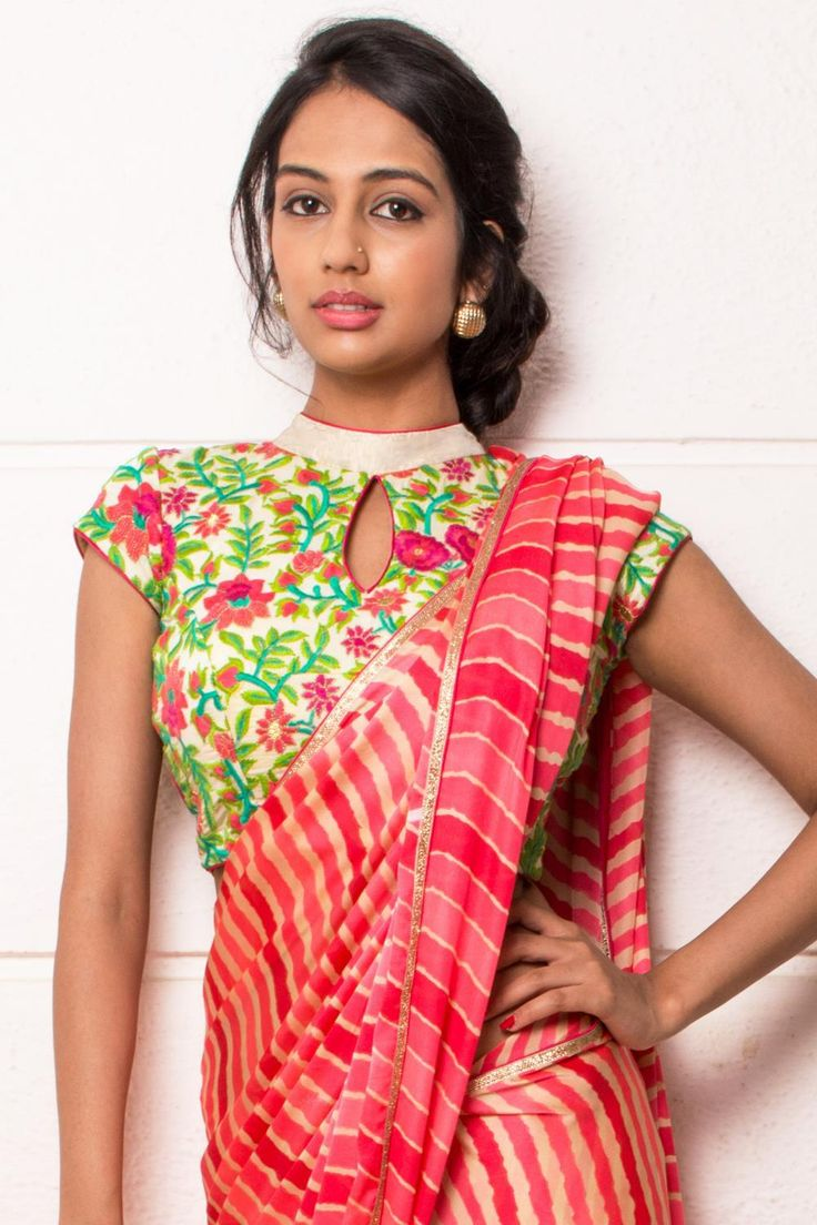 DESCRIPTION: A threadwork pattern of vines, leaves and flowers in vidid green, pink and red against a background of off-white adds artistic appeal to this charmingly demure high-neck blouse. Push the look even further with a funky hair do and sky high heels to create a stir. Whatsapp +91 81050 68601. *Shipping worldwide* #saree #blouse #sareeblouse #blousedesigns #desi #indianfashion #india #bollywood #floral #threadwork #multicolor