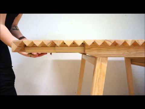 Wooden tablecloth folds out to form table extensions