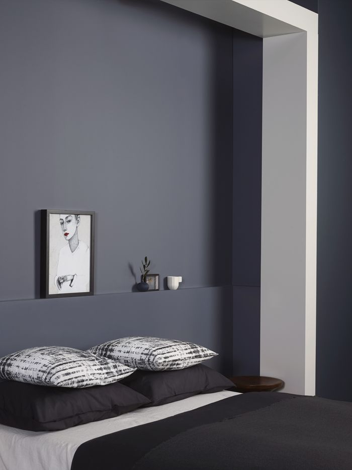 Dark, calming walls in the bedroom + minimalist decor