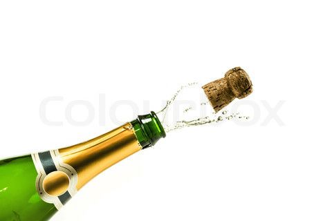 Stock image of 'Bottle of champagne popping at new years eve'