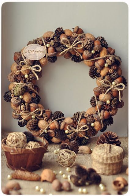 This pine cone and acorn wreath is perfect for your door this holiday season, on Vekoria.