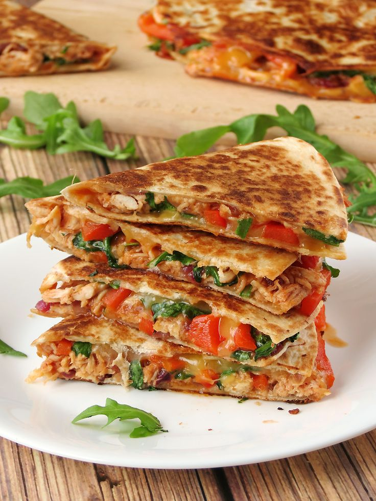 This delicious chicken quesadilla with caramelized onions, grilled red bell pepper and fresh arugula is perfect for a quick lunch.