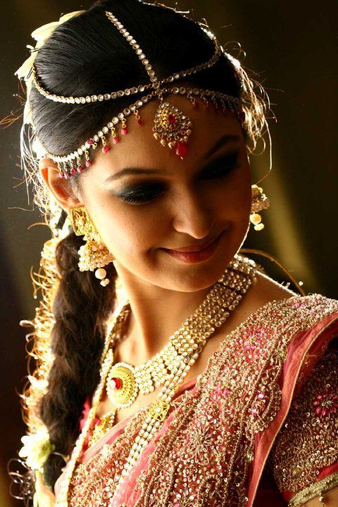 Maang tikka, Indian wedding jewelry.  Beautiful traditional indian bridal wear, with wedding lehengas or wedding sarees for an indian wedding.