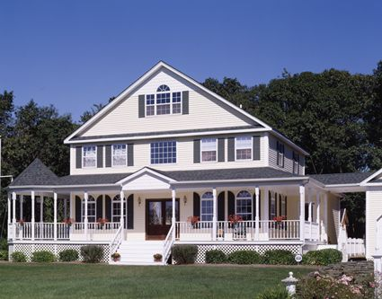 This spacious four bedroom farmhouse style home is for Large farmhouse house plans