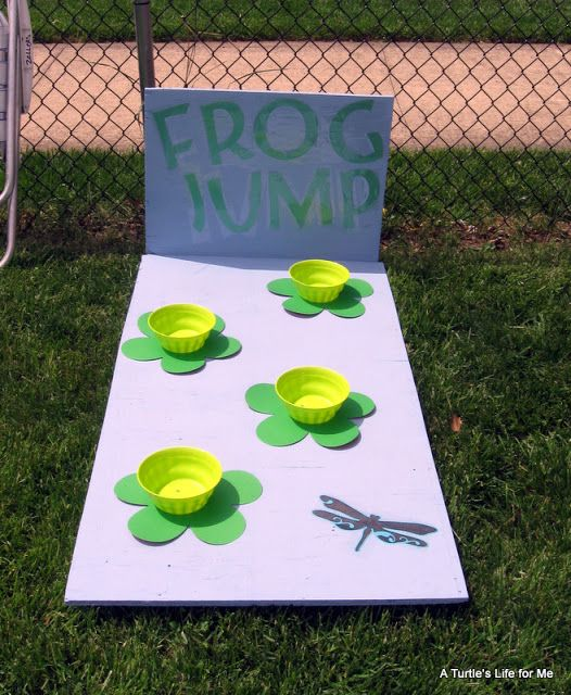 Frog Jump Game - kids try to throw plastic frogs into lily pad cups from behind a line. Blogger found frogs after Easter by the rubber ducks.