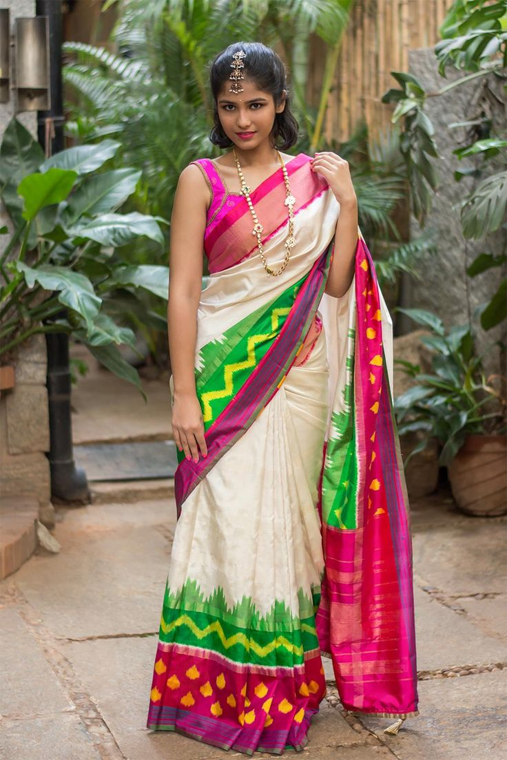 This saree is a true desi girl. Colorful, Ikat print, Pochampally Silk - perfect concoction for this festival season. The bright hues of green, red against the pink border works perfect with the elegant cream saree to give you the perfect ensemble. Work her with a hot pink blouse or lay low with a neutral gold blouse - either way you have a winner in this saree! #saree #pochampally #ikkat #handloom #indian # saree