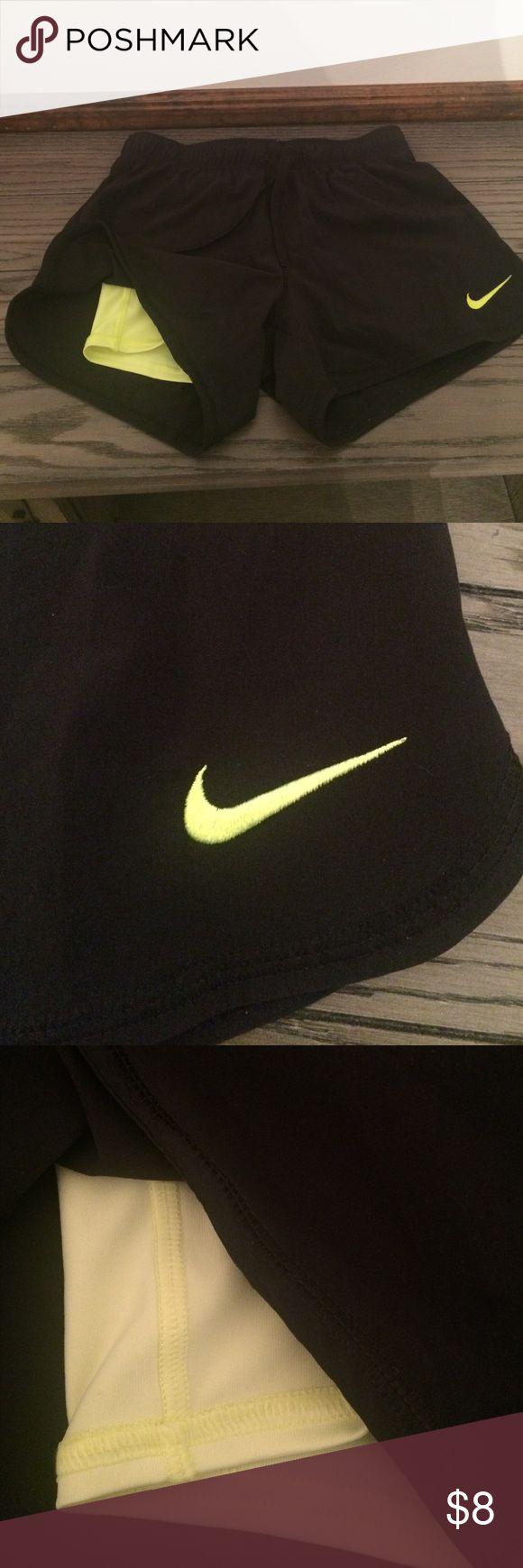Nike women's 2 in 1 phantom shorts size XS Nike women's 2 in 1 phantom shorts. Size XS. Black and neon yellow. Shorts feature under tight shorts. Nike Shorts